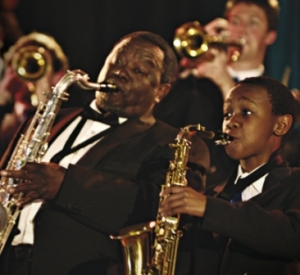 Hlayani Junior Mabasa (right) plays Felix, A South African boy with jazz dreams.