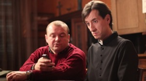 Kresimir Mikic (right) plays a priest with a plan in The Priest's Children.