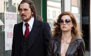 Christian Bale and Amy Adams are partners in crime in American Hustle.