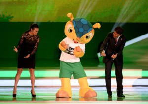 Fuleco dancing with hosts at the World Cup Draw in December 2013.