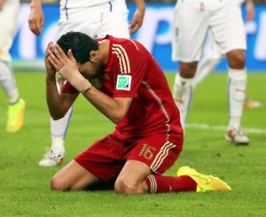 Spanish player Sergio Busquets is devastated after Spain's loss to Chile. That loss prevents Spain from advancing past the Group Stage.