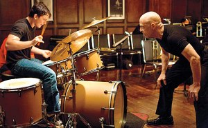 J.K. Simmons plays a jazz instructor inflicting tyrannical teaching methods on Miles Teller in Whiplash.