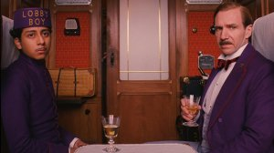 A hotel owner and his lobby boy (played by Tony Revoloro and Ralph Fiennes) go on a bizarre adventure in The Grand Budapest Hotel.
