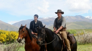Slow West is of a bounty hunter, played by Michael Fassbender (right), helping a Scottish émigré, played by Kodi Smit-McPhee (left), reunite with the woman he loves.