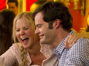 Amy Schumer and Bill Hader star as an unlikely couple in the unlikely romantic comedy Trainwreck.